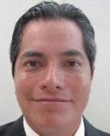 Fotografía oficial del funcionario público César Langarica Santana